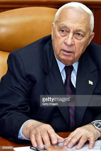 Israeli Prime Minister Ariel Sharon opens the weekly cabinet meeting at his office March 14 2004 in Jersalem Israel The discussion was dominated by...