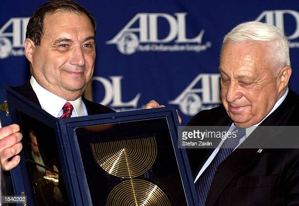 Israeli Prime Minister Ariel Sharon receives the Anti-Defamation League's Distinguished Statesman Award from ADL National Director Abraham H. Foxman...