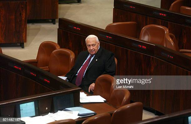 Israeli Prime Minister Ariel Sharon seats during a Knesset Israel's Parliament session in Jerusalem Monday January 10 2004 Sharon's new government...