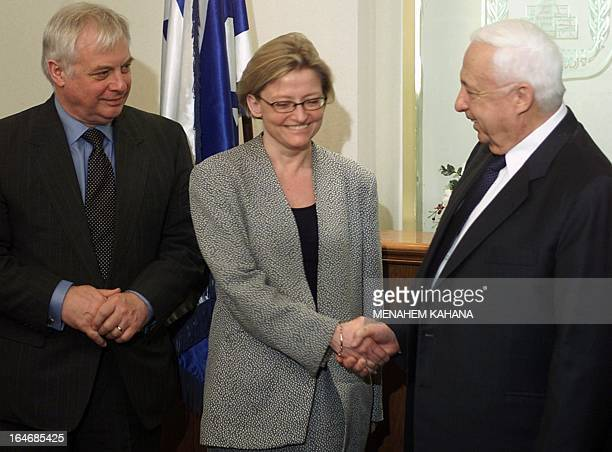 Israeli Prime Minister Ariel Sharon shake hands with Swedish Foreign Minister Anna Lindh while European Union Commissioner for External Affairs Chris...