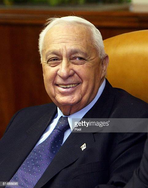 Israeli Prime Minister Ariel Sharon smiles at the beginning of his weekly cabinet meeting at his office on October 17 2004 in Jerusalem Israel After...
