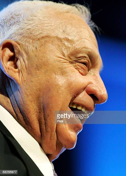 Israeli Prime Minister Ariel Sharon smiles during a meeting with Israeli police commanders on July 14 2005 in the costal city of Ashdod Israel Sharon...