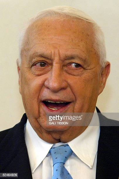 Israeli Prime Minister Ariel Sharon speaks during an official meeting at his Jerusalem office 22 March 2005 Four rebel MPs from Sharon's rightwing...