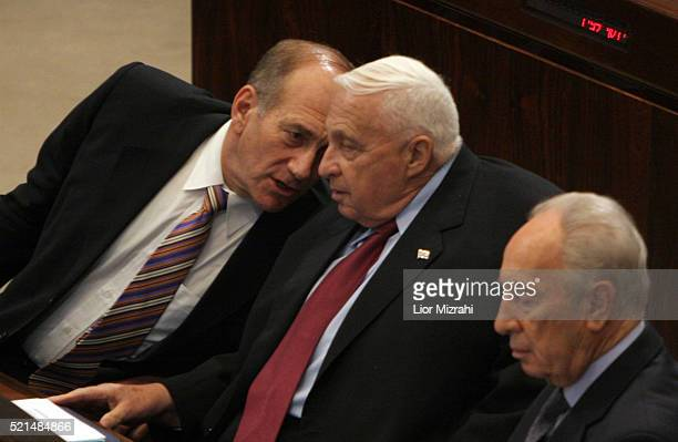 Israeli Prime Minister Ariel Sharon speaks to Vice Premier Ehud Olmert and Vice Premier Shimon Peres in the Knesset, Israeli Parliament, on November...