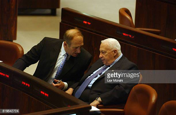 Israeli Prime Minister Ariel Sharon speaks with Vice Prime minister Ehud Olmert at the Knesset, Israel's parliament, in Jerusalem Thursday April 22,...