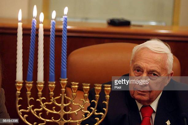 Israeli Prime Minister Ariel Sharon takes part in the lighting of the fourth Hanukkah candle at his Jerusalem offices December 28 2005 in Jerusalem...
