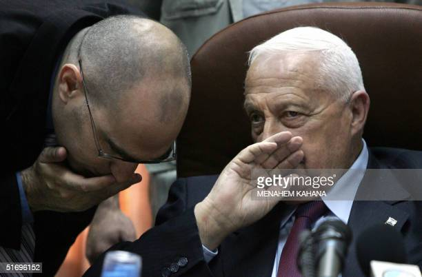 Israeli Prime Minister Ariel Sharon talks to an advisor during a Likud party meeting in the Knesset in Jerusalem 08 November 2004. The party met to...