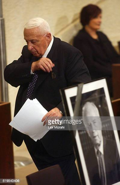 Israeli Prime Minister Ariel Sharon walks past photo of assassinated prime minister Yitzhak Rabin in the Knesset after Sharon on Wednesday October 27...