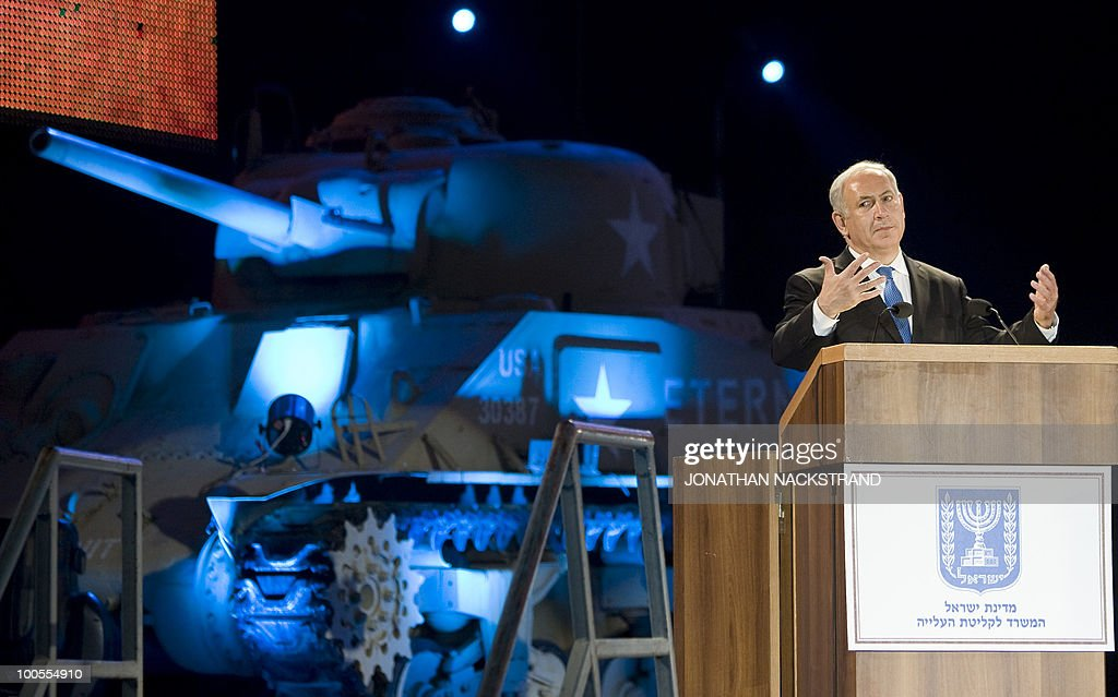 Israeli Prime Minister Benjamin Netanyahu addresses a ceremony honoring World War II veterans and marking the 65th anniversary of the Allied victory over Nazi Germany at the Armored Corps Memorial and Museum at Latrun Junction near Jerusalem on May 25, 2010.