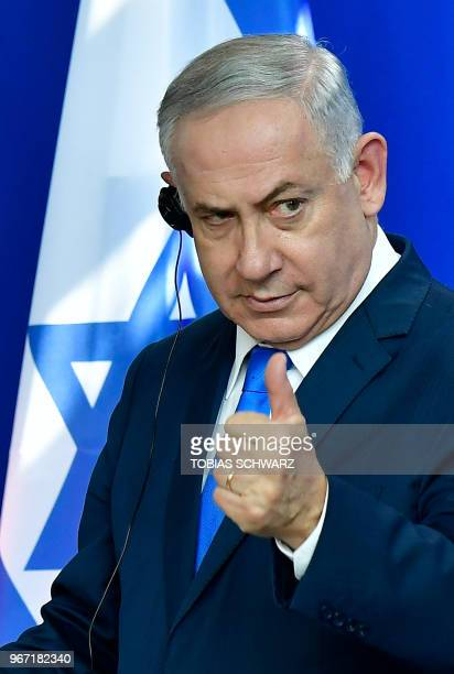 Israeli Prime Minister Benjamin Netanyahu addresses a press conference after a meeting with the German chancellor at the Chancellery in Berlin on...