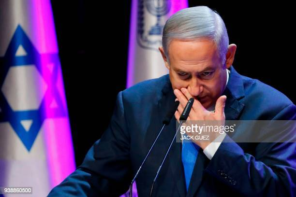 Israeli Prime Minister Benjamin Netanyahu addresses the annual health conference in Tel Aviv on March 27 2018 Netanyahu was undergoing tests in the...