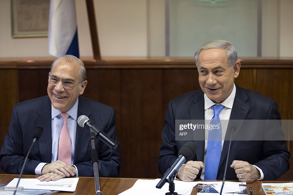 Israeli Prime Minister Benjamin Netanyahu (R) and Angel Gurria, Secretary General of the Organisation for Economic Co-operation and Development (OECD), attend the weekly cabinet meeting in his offi...