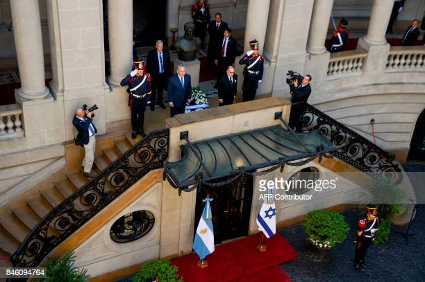 Israeli Prime Minister Benjamin Netanyahu and Argentina's Foreign Minister Jorge Faurie participate in a wreathlaying ceremony paying homage to...
