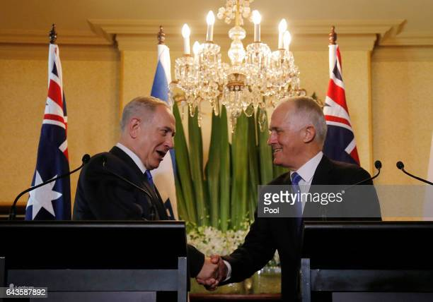 Israeli Prime Minister Benjamin Netanyahu and Australian Prime Minister Malcolm Turnbull shake hands during their joint press conference at...
