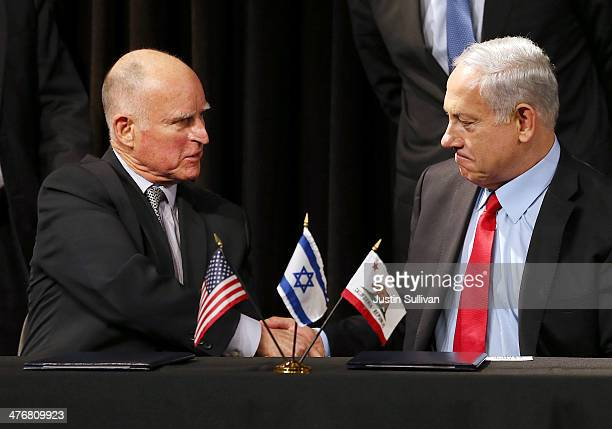 Israeli prime minister Benjamin Netanyahu and California governor Jerry Brown shake hands after signing a pact to strengthen economic and research...