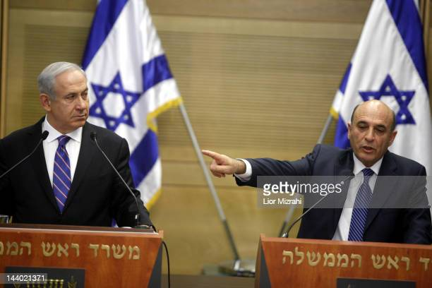 Israeli Prime Minister Benjamin Netanyahu and centrist Kadima party leader Shaul Mofaz attend a joint press conference in the Knesset to announce a...