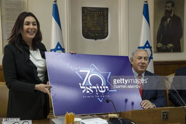 Israeli Prime Minister Benjamin Netanyahu and Culture and Sport Minister Miri Regev present a logo for Israel's 70th anniversary celebrations during...