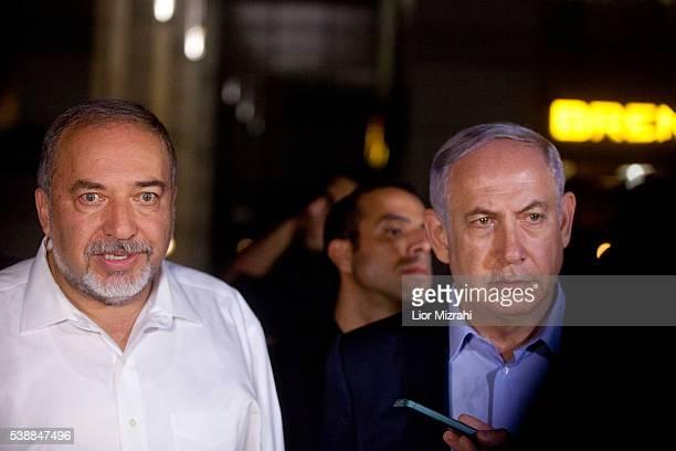 Israeli Prime Minister Benjamin Netanyahu and Defence Minister Avigdor Liberman speak to the press at the scene of a shooting outside Max Brenner...