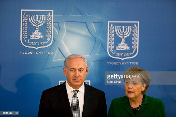 Israeli Prime Minister Benjamin Netanyahu and German Chancellor Angela Merkel pose during a joint press conference in Netanyahu's office on January...