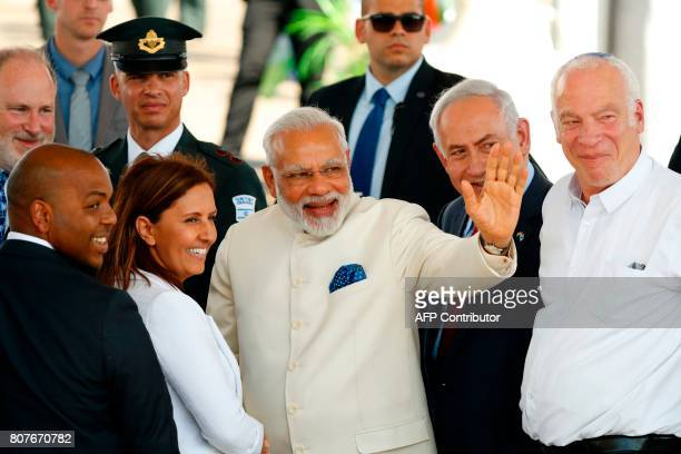 Israeli Prime Minister Benjamin Netanyahu and his Indian counterpart Narendra Modi greet officials during an official ceremoney at BenGurion...