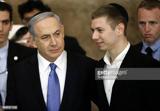 Israeli Prime Minister Benjamin Netanyahu and his son Yair visit on March 18 the Wailing Wall in Jerusalem following his party Likud's victory in...