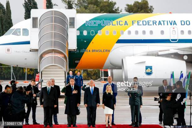 Israeli Prime Minister Benjamin Netanyahu and his wife Sara along with visiting Brazilian President Jair Bolsonaro listen to the national anthems...