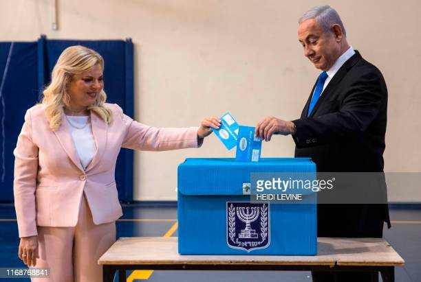Israeli Prime Minister Benjamin Netanyahu and his wife Sara cast their votes at a voting station in Jerusalem on September 17 2019