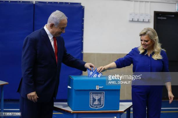 Israeli Prime Minister Benjamin Netanyahu and his wife Sara cast their votes during Israel's parliamentary elections in Jerusalem on April 9 2019...