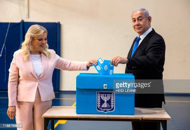 TOPSHOT Israeli Prime Minister Benjamin Netanyahu and his wife Sara casts their votes at a voting station in Jerusalem on September 17 2019