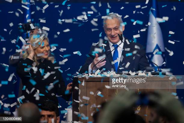 Israeli Prime Minister, Benjamin Netanyahu and his wife Sara Netanyahu smile at the Likud Party after vote celebration on March 3, 2020 in Tel Aviv,...