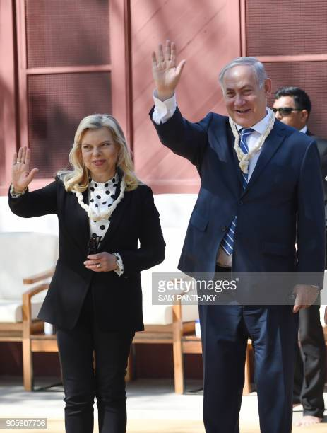 Israeli Prime Minister Benjamin Netanyahu and his wife Sara Netanyahu wave during a visit with Indian Prime Minister Nerendra Modi to the Gandhi...