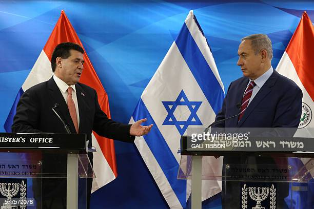 Israeli Prime Minister Benjamin Netanyahu and Paraguayan President Horacio Cartes give a joint statement to the press as they meet at Netanyahu's...