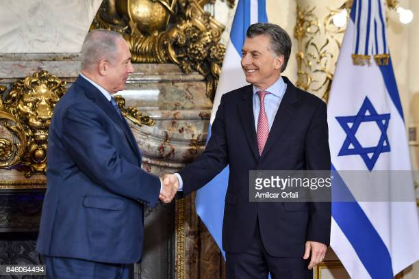 Israeli Prime Minister Benjamin Netanyahu and President of Argentina Mauricio Macri shake hands during a meeting as part of the official visit of...