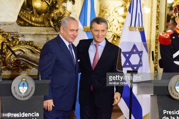 Israeli Prime Minister Benjamin Netanyahu and President of Argentina Mauricio Macri pose for pictures during a meeting as part of the official visit...