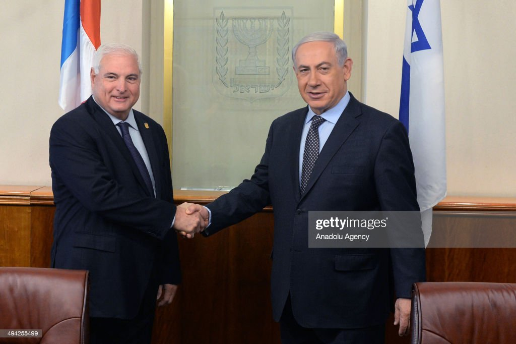 Israeli Prime Minister Benjamin Netanyahu (R) and President of Panama Ricardo Martinelli (L) shake hands during their meeting at Prime Ministry's office in Jerusalem, Israel on May 29, 2014.