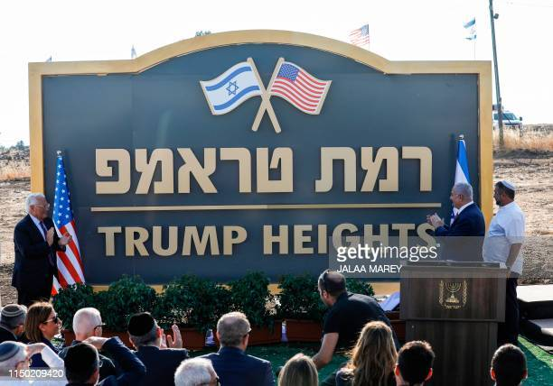 Israeli Prime Minister Benjamin Netanyahu and US Ambassador to Israel David Friedman applaud after unveiling the place-name sign for the new...