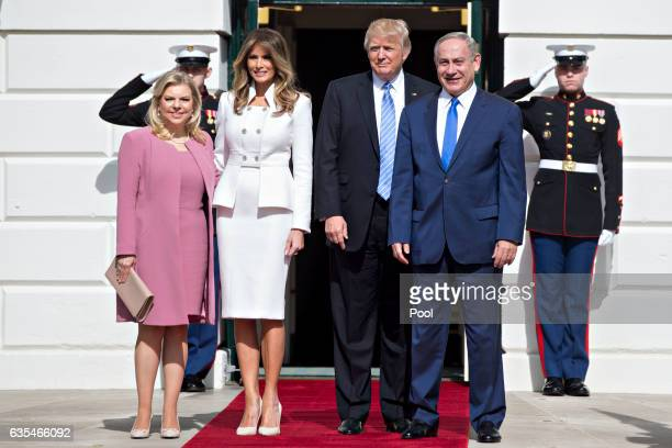 Israeli Prime Minister Benjamin Netanyahu and U.S. President Donald Trump stand with their wives first lady Melania Trump and Sara Netanyahu as they...