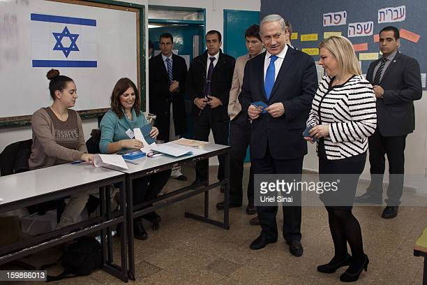 Israeli Prime Minister Benjamin Netanyahu arrives with his wife Sara Netanyahu to cast their ballot at a polling station on election day on January...