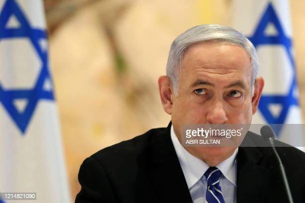 Israeli Prime Minister Benjamin Netanyahu attends a cabinet meeting of the new government at Chagall State Hall in the Knesset in Jerusalem on May 24...