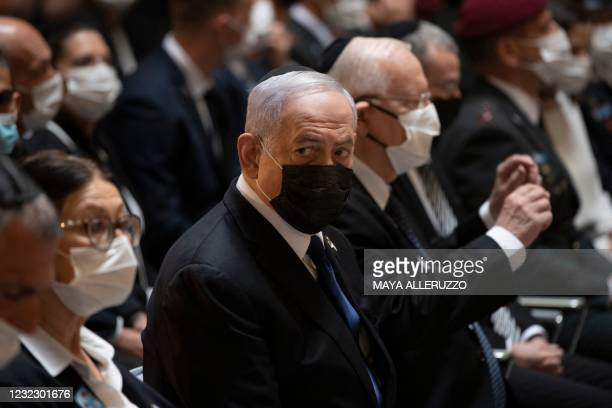 Israeli Prime Minister Benjamin Netanyahu attends a ceremony honouring Israel's fallen soldiers at the Mount Herzel military cemetery in Jerusalem...