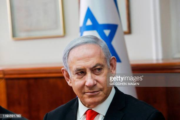 Israeli Prime Minister Benjamin Netanyahu attends the weekly cabinet meeting at his office in Jerusalem on January 19, 2020.