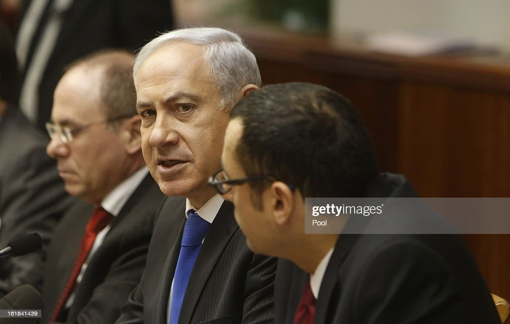 Israeli Prime Minister Benjamin Netanyahu (C) attends the weekly cabinet meeting on February 17, 2013 in Jerusalem, Israel. Netanyahu made a statement reaffirming his trust in the Israeli security forces and asking that they be spared undue media attention, a response made in relation to the 'Prisoner X' affair in which the suicide in Ayalon Prison of an Australin immigrant to Israel is speculated to have been espionage related and with Mossad involvement.
