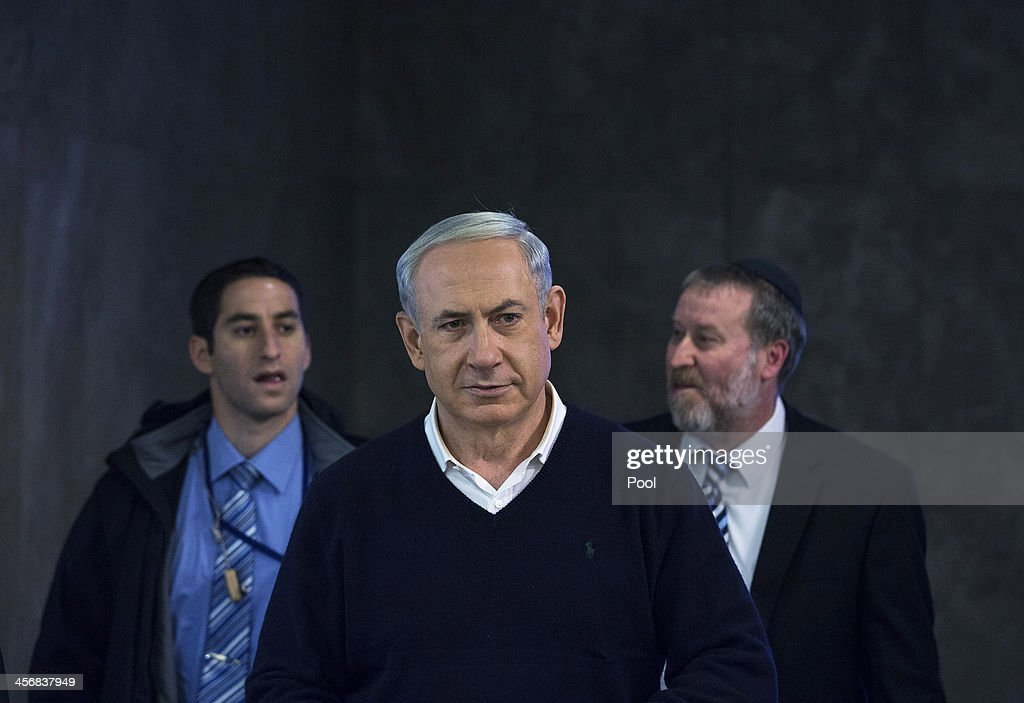 Israeli Prime Minister Benjamin Netanyahu attends the weekly cabinet meeting December 15, 2013 in Jerusalem, Israel.