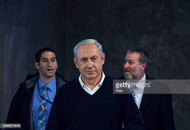 Israeli Prime Minister Benjamin Netanyahu attends the weekly cabinet meeting December 15 2013 in Jerusalem Israel