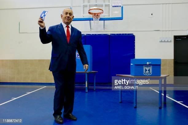 TOPSHOT Israeli Prime Minister Benjamin Netanyahu casts his vote during Israel's parliamentary elections in Jerusalem on April 9 2019 Israelis voted...