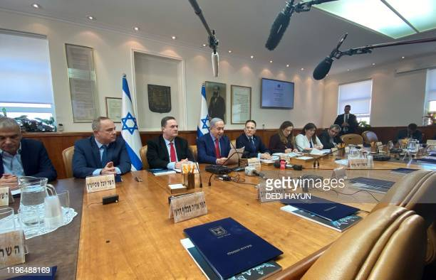 Israeli Prime Minister Benjamin Netanyahu chairs his weekly cabinet meeting at his office in Jerusalem on January 26, 2020.