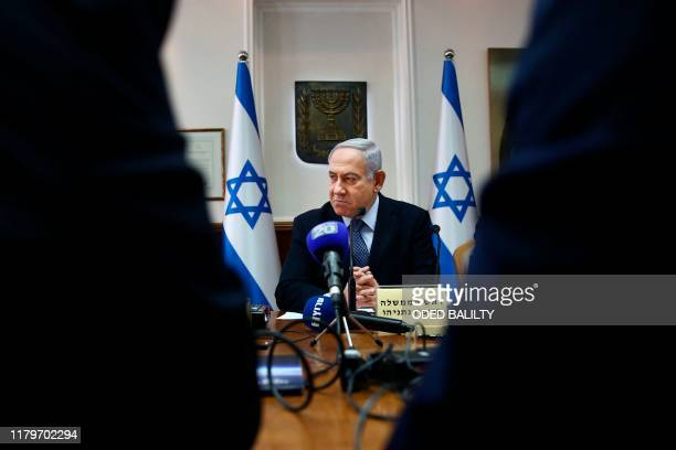 Israeli Prime Minister Benjamin Netanyahu chairs the weekly cabinet meeting at his office in Jerusalem on November 3, 2019.