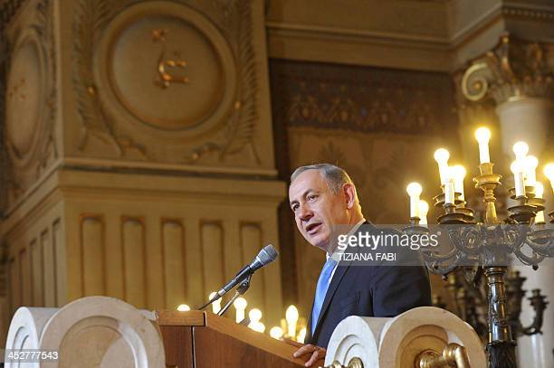 Israeli Prime Minister Benjamin Netanyahu delivers a speech on December 1st 2013 at the Great Synagogue of Rome during the start of the Jewish light...