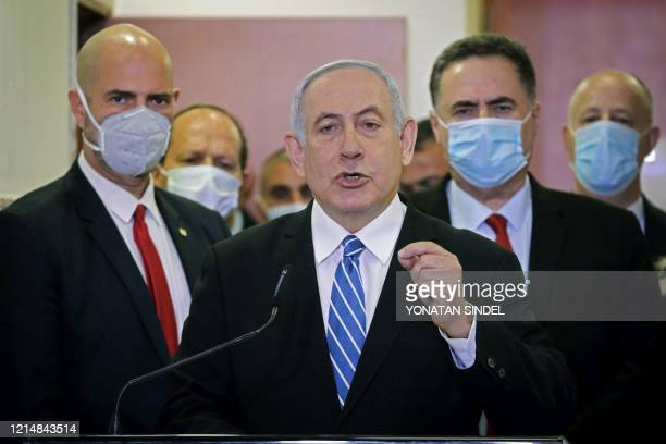 TOPSHOT Israeli Prime Minister Benjamin Netanyahu delivers a statement before entering a courtroom at the district court of Jerusalem on May 24...