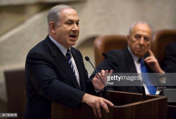 Israeli Prime Minister Benjamin Netanyahu delivers his speech at the opening of the winter session of the Knesset, Israel's Parliament, October 12,...